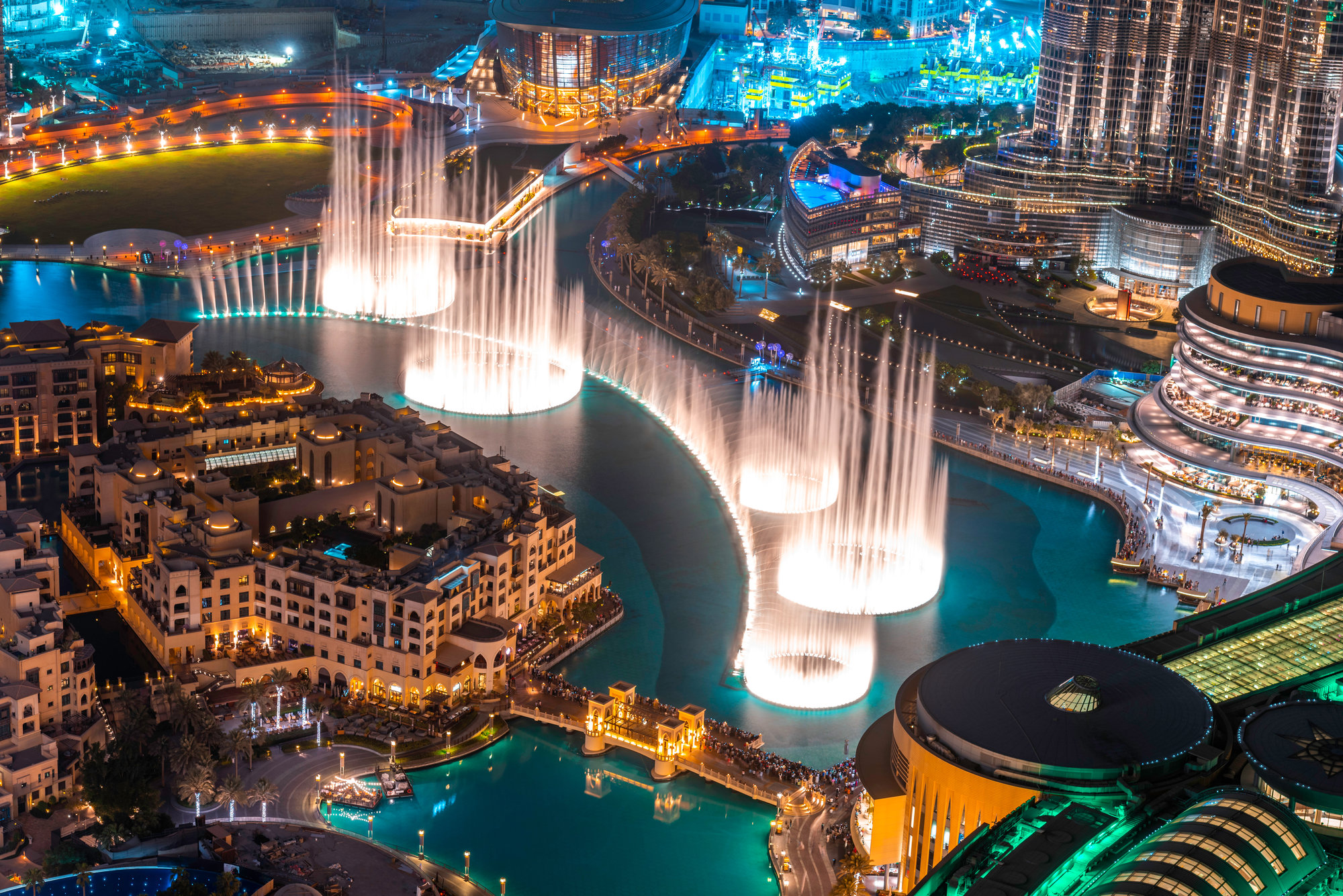 a fountain below Burj Khalifa