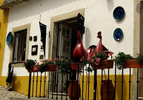 kohout - jeden ze symbolů portugalské nevinnosti