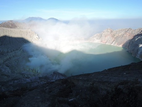 Ijen volcano crater is constantly veiled in smoke