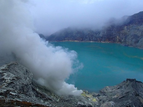 an acid lake on the bottom of the crater