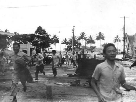 ľudia utekajú pred tsunami, Hilo 1946