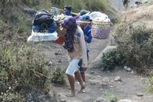 bearers wear only flip-flops up Rinjani volcano