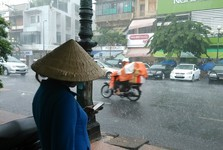 locals drive motorbikes even in rain