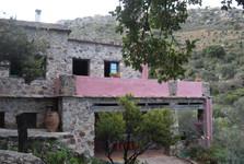 a stone house in Milia eco village