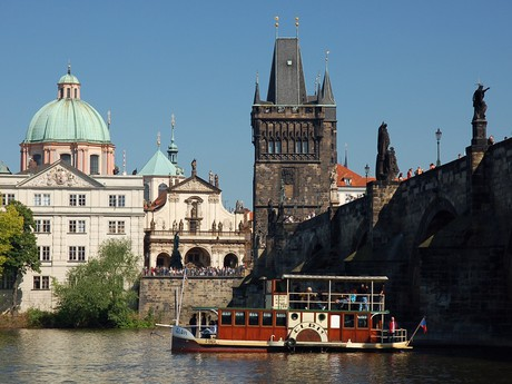 a small paddle steamer at the Charles Bridge