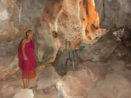 a monk guiding us through the caves