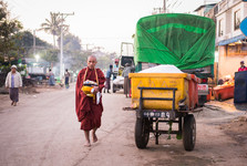 monks have to go out into the streets to get their breakfast