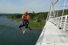 a swing hanging from the bridge across Vranovska bay